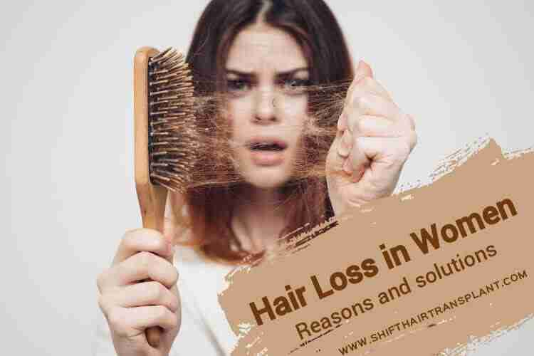 Women Hair Loss, a shocked brunette showing hair fallen hair in her brush.