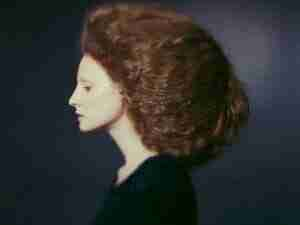 A Victorian style vintage redhead female with thick hair.