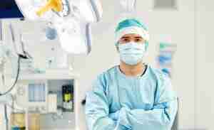 A surgeon standing in an operating room.