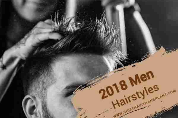 2018 Men Hairstyles, A female barber spraying hair a male customer's hair in black and white.