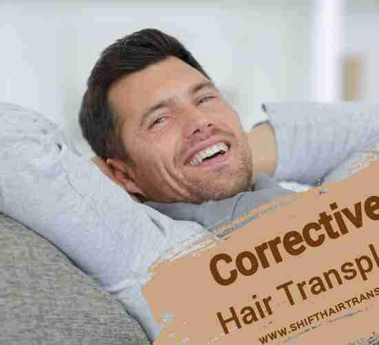 Corrective Hair Transplant, a happy man in a grey blouse sitting on the sofa.