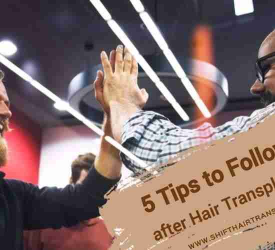 Hair Transplant Aftercare Tips, a Hipster male giving a high five to a Middle Eastern bald man.