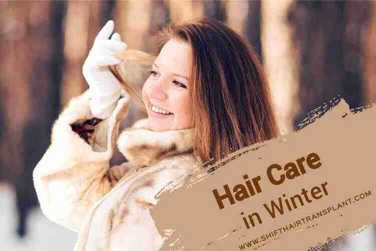 Winter Hair Care, a happy woman holding her hair in the snowy woods.