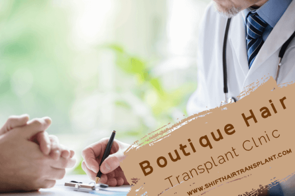 Boutique Hair Transplant Clinic, a doctor writing with a black pen.